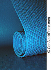 Yoga mat - Close up of a yoga mat, half rolled, half open