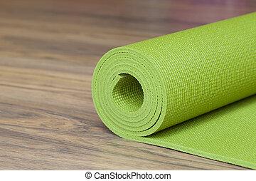 yoga mat - A yoga mat is set on the floor