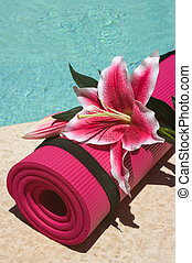 Yoga Mat - Yoga mat and a beautiful lily near a pool