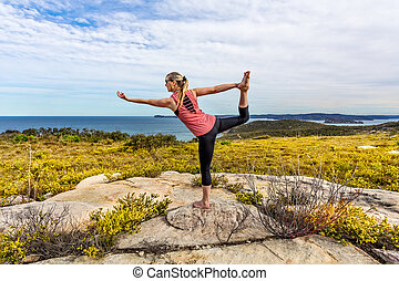 Yoga, Natarajasana, or Lord of the Dance among wildflowers