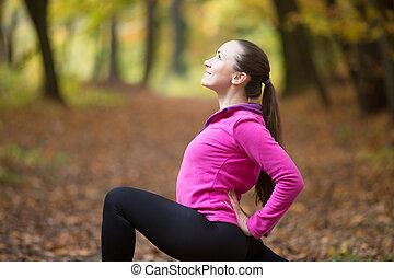 Yoga outdoors: anjaneyasana pose