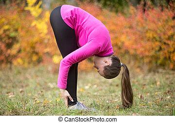 Yoga outdoors: uttanasana pose