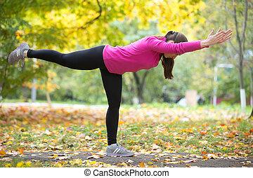 Yoga outdoors: Virabhadrasana Three pose