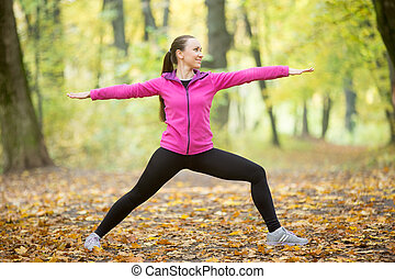 Yoga outdoors: Warrior Two pose