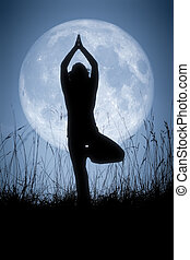 An image of a pretty woman doing yoga under a big pale moon