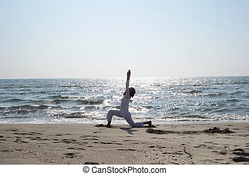 bikram yoga dhanurasana pose at beach yoga teacher