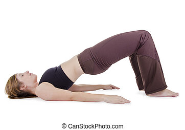 yoga pose - female in sport clothes performing exercise, isolated on white.