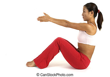 Yoga Position - A female fitness instructor demonstrates a...