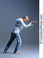 yoga posture - A man doing yoga exercises. Studio shot over ...