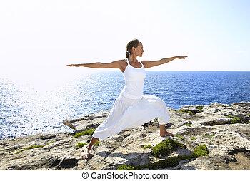Yoga posture on rocks
