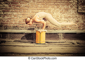 yoga practicing - Beautiful young woman practicing yoga on...