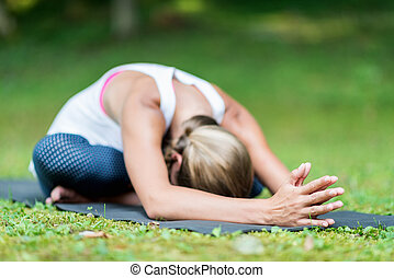 Yoga Setated Forward Bend - Girl doing Yoga, seated forward...