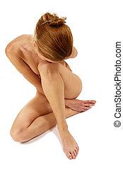Yoga - Sexy naked girl making yoga. Isolated on white