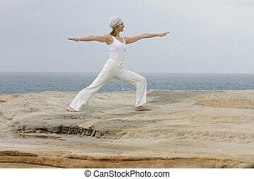 Yoga - Woman Yoga by the ocean
