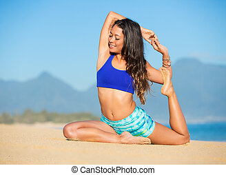 Yoga - Happy relaxed young woman practicing yoga outdoors at...