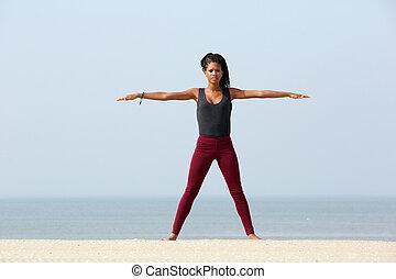 Yoga stretch at the beach