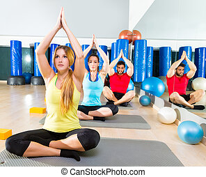 Yoga training exercise in fitness gym people group relaxed...
