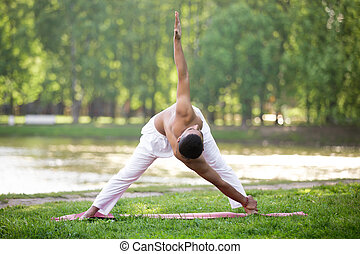 root chakra pose variation sporty indian young man
