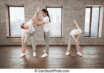 Yoga tutor helping his visitors