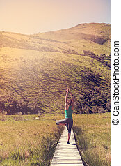 Yoga with young woman in the nature