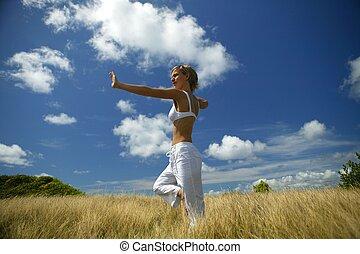 Yoga woman in a field