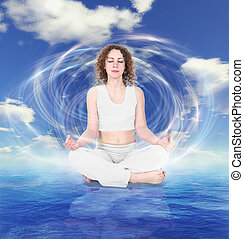 yoga woman in withe dress on sky water background collage
