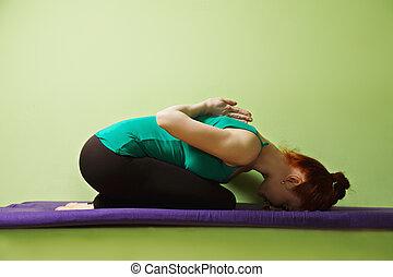 Yoga woman inclined forward