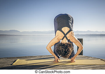 yoga woman lake