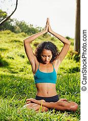 yoga woman on green grass