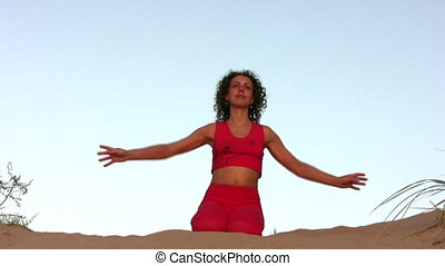 yoga woman on sand