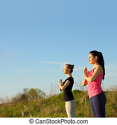 yoga woman over blue sky background