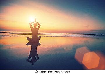 Yoga woman sitting in lotus pose