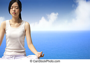 yoga woman with blue ocean background