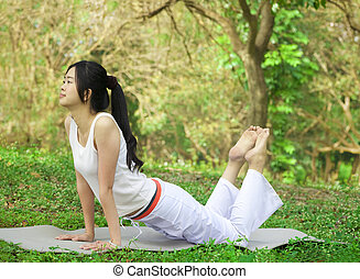 yoga young woman on park