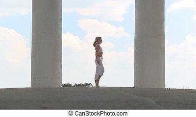 Yogatemple 001 - woman practising yoga between two pillars
