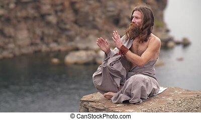 Yogi on the rock near the river