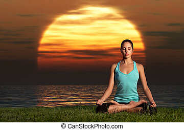 Yogi sunrise. - A sportive beautiful woman training yoga on...