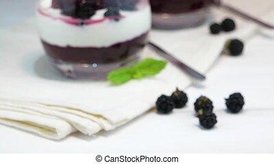 Yogurt desert with raspberries, blackberry and mint.
