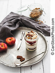 Yogurt oat granola with berries, honey, nuts and nectarins...