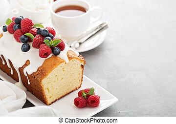 Yogurt pound cake with glaze and fresh berries - Yogurt...