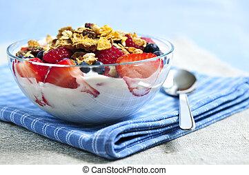 Serving of yogurt with fresh berries and granola