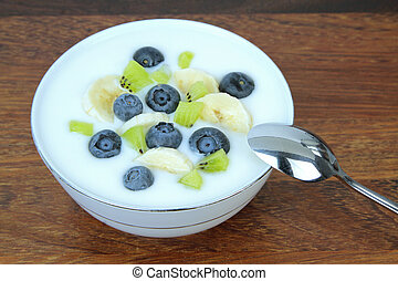 Yogurt with blueberries, kiwi and banana slices