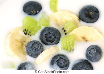 Yogurt with blueberries, kiwi and banana slices.