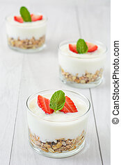 Yogurt with cereals and strawberrie
