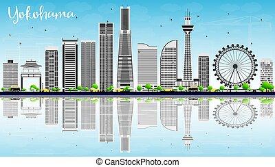 Yokohama Skyline with Gray Buildings, Blue Sky and Reflections.