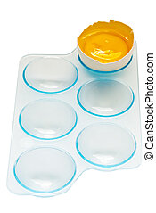 yolk in blue plastic tray isolated on a white background