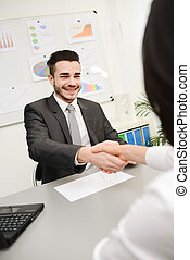 yong businessman in transaction shaking hand of client