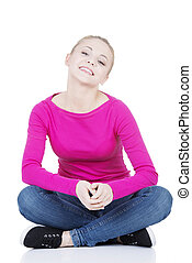 Yong happy casual woman sitting on floor