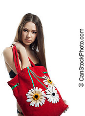 Yong woman portrait with red beach bag isolated