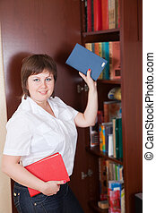 woman selecting book